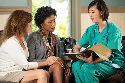 young doctor talking with two women
