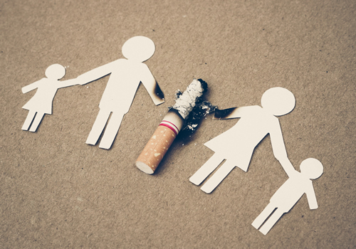 paper cutout people holding a used cigarette